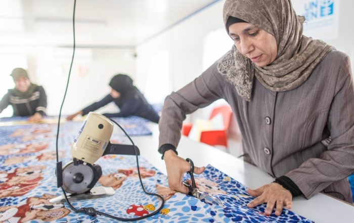 People of Jordan working on textiles.